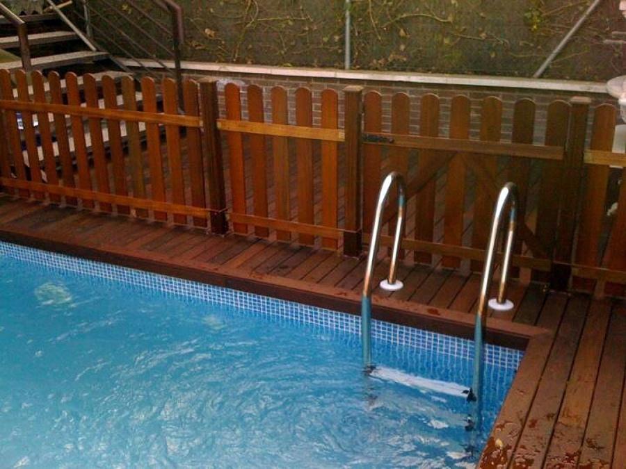 Foto piscina y valla de madera ipe de radu marin piscinas s l 467987 habitissimo - Vallas de madera para piscinas ...
