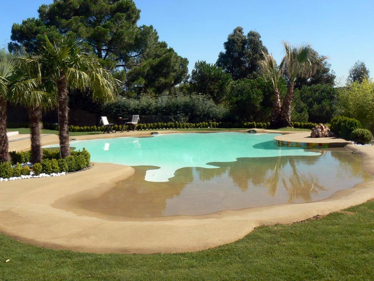 foto piscinas de arena de construcciones y proyectos