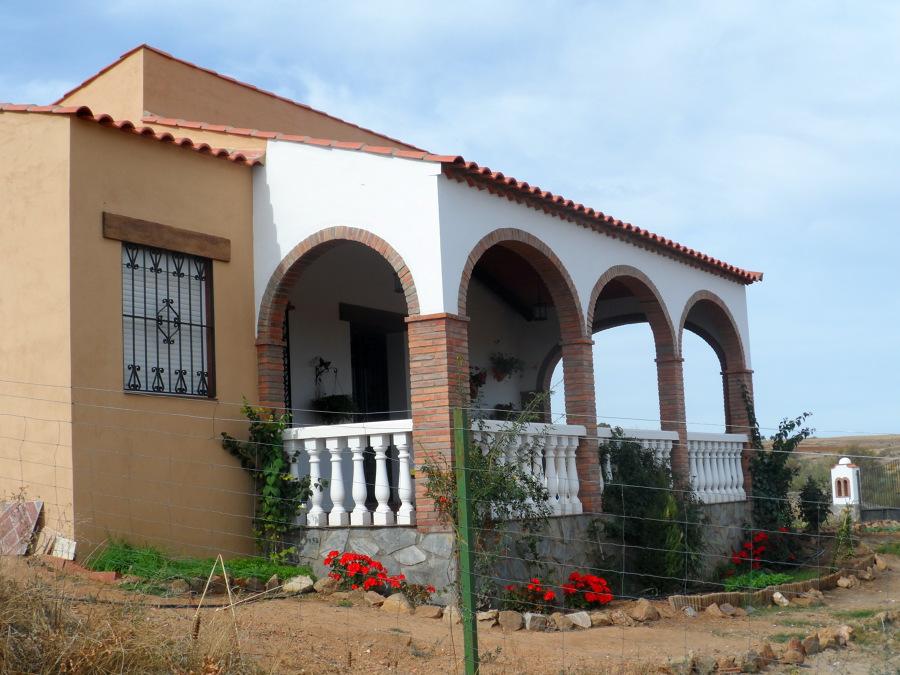 foto porche casa de campo de construcciones olivares y
