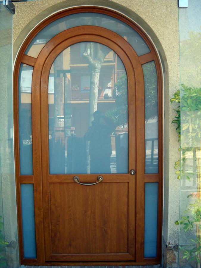 Porta pvc corbada color roure daurat