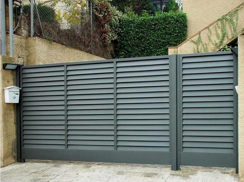 Foto puerta corredera residencial de teckendoor s l - Puertas de hierro para jardin ...