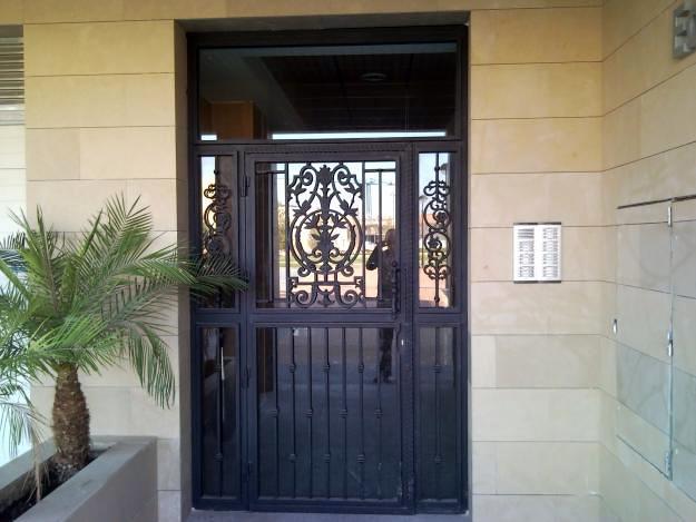 puerta de entrada forja-cristal