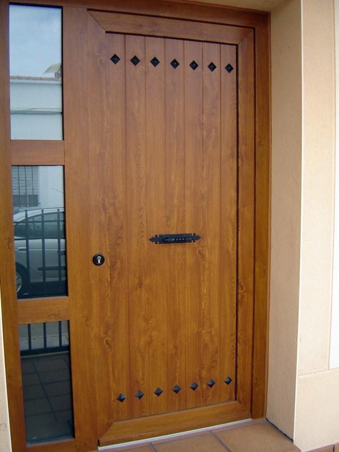 Pin puertas entrada aluminio color madera carpinteria for Puertas color madera