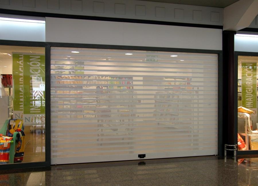 Foto Puerta Enrollable De Aluminio Microperforada De