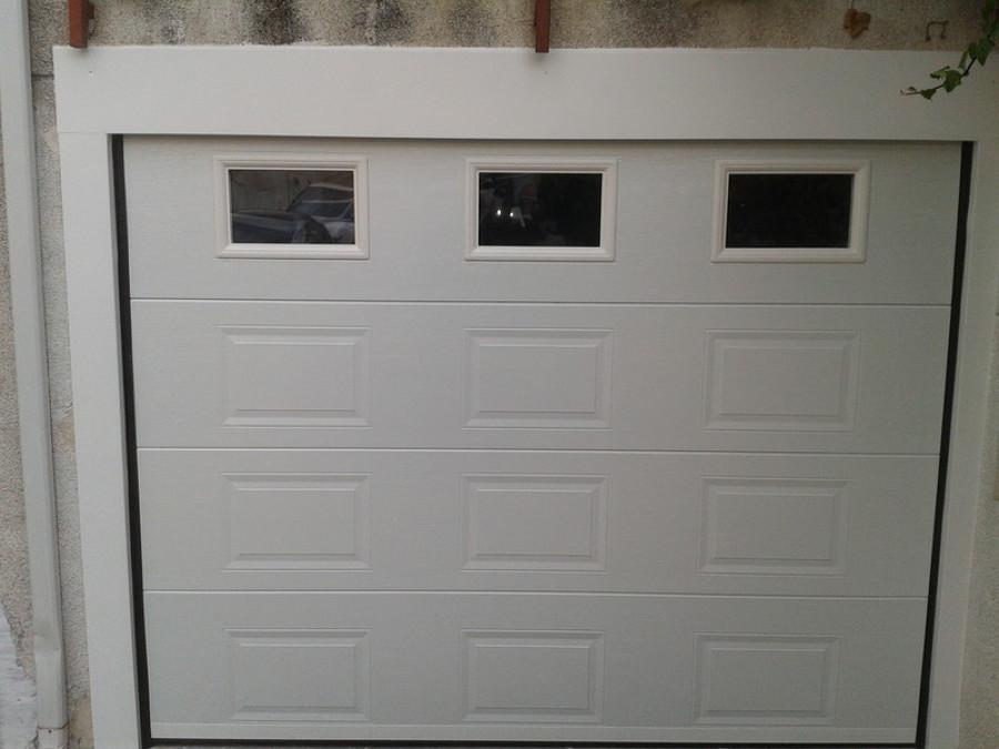 Foto puerta seccional cuarteron y ventanas de josecu for Puertas de garaje precios