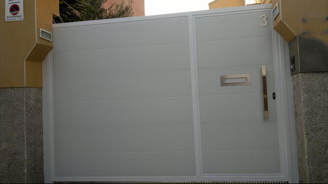 Puertas parking + peatonal