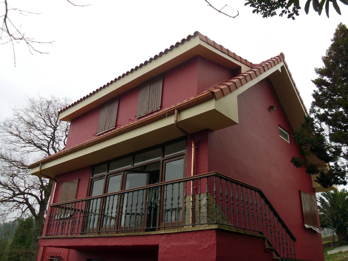 Reforma de cubierta y fachada.