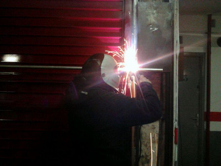 Reparación puerta garaje comunitario