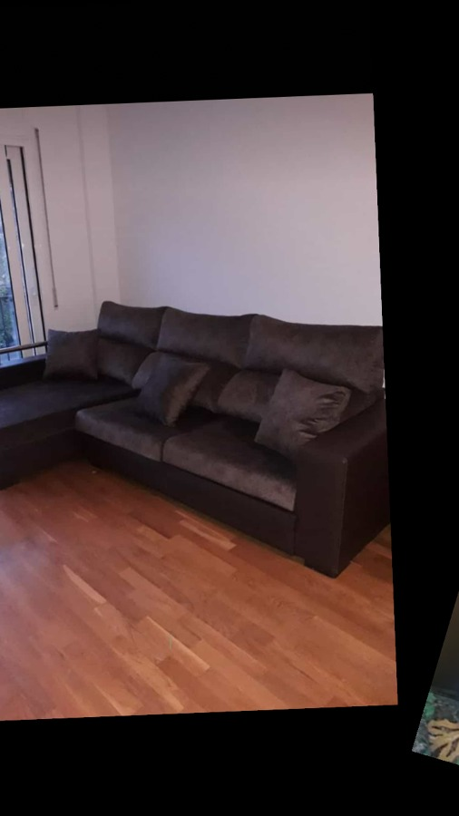 Sofá tapizado en polipiel