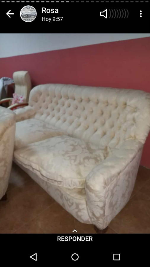 Sofá tapizado en capitone