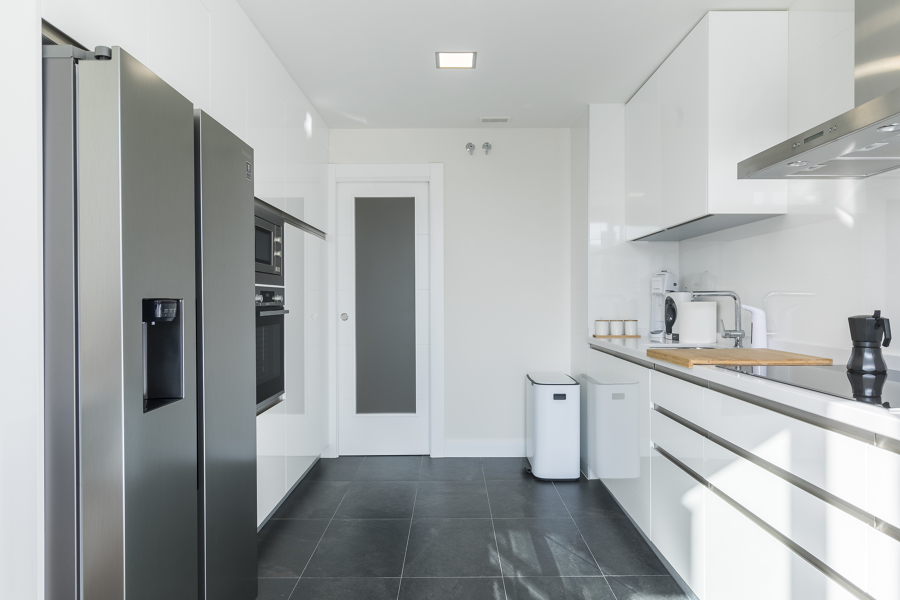Cambio de puerta abatible a corredera en cocina