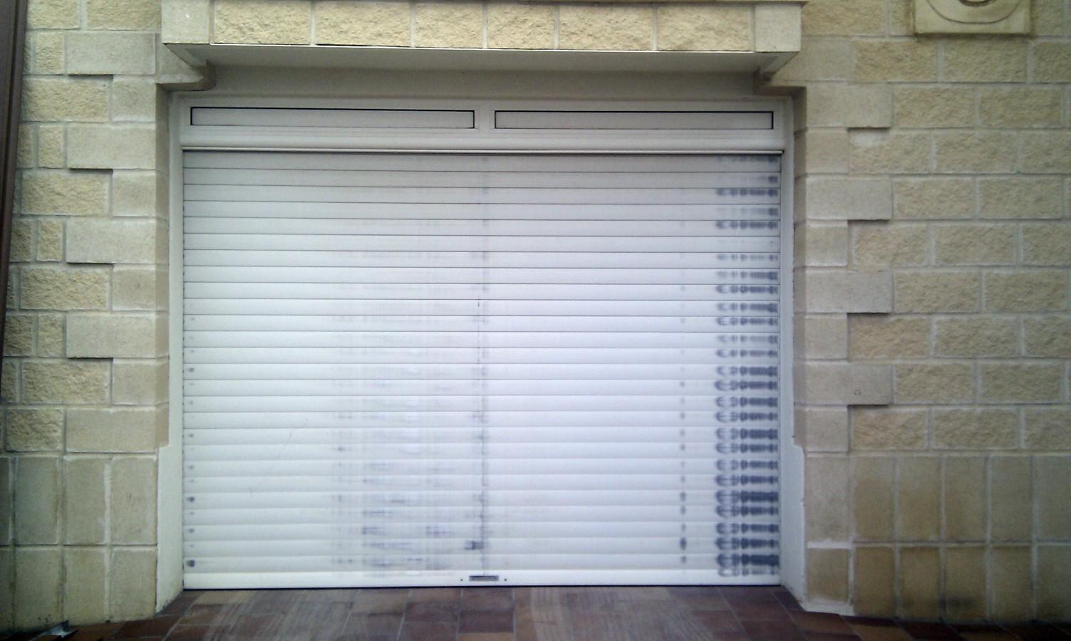Sustitucion de puerta enrollable de cochera por Puerta Seccional(1)