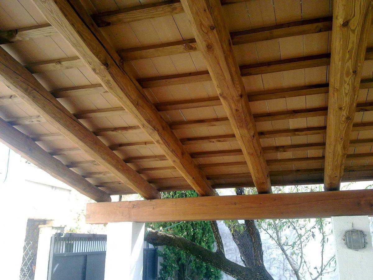 Foto techos con vigas de madera de av construccions s c for Tejados de madera para puertas
