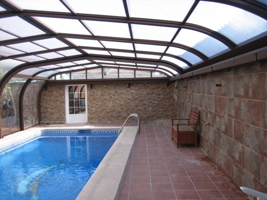 Foto vega line telescopica adosada de cubiertas de for Piscinas cubiertas salamanca