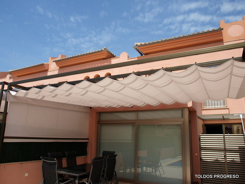 Foto toldo corredero o palilleria de progreso c b for Toldos para terrazas en azoteas