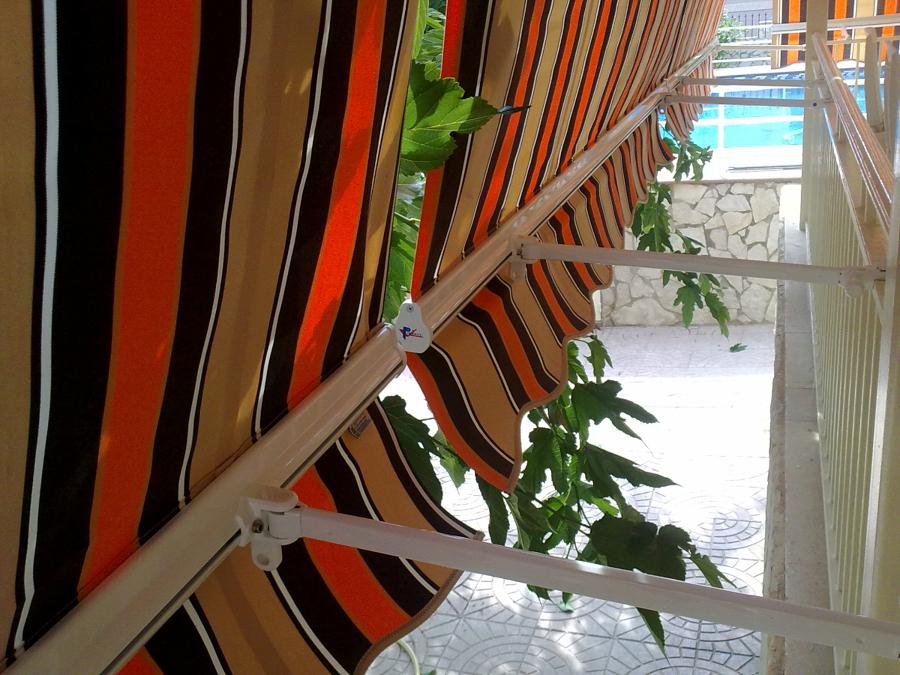 Foto toldos telon para balcon de boronat aluminio y pvc for Precio toldos balcon