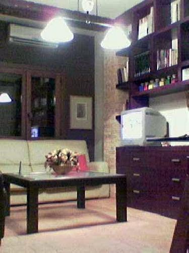 Vivienda unifamiliar en bloque sita en Sevilla. Librería a medida