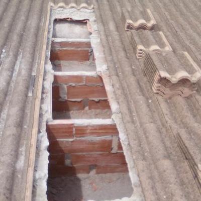 Aislamiento bufado de celulosa en tejado