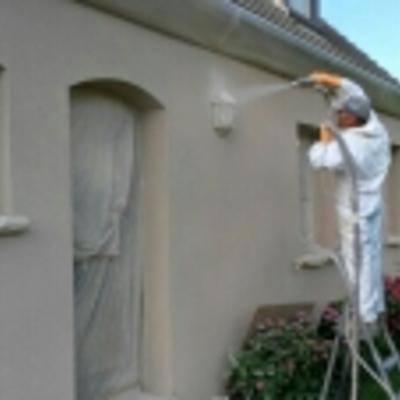 aplicación corcho proyectado fachada