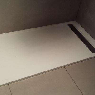 plata de ducha con rejillla central
