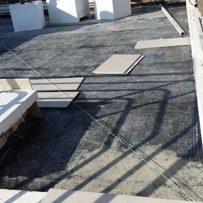 Colocación de tela asfáltica en terrado