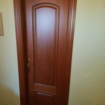 sustitución puerta paso modelo provenzal medio punto barnizada