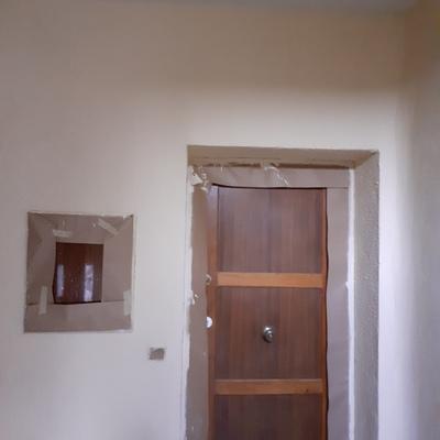 Preparacion de paredes, protección de puertas y ventanas