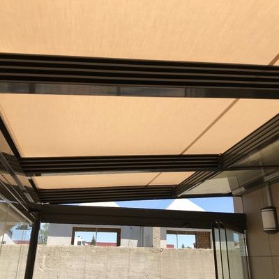 Veranda sobre techo móvil de cristal