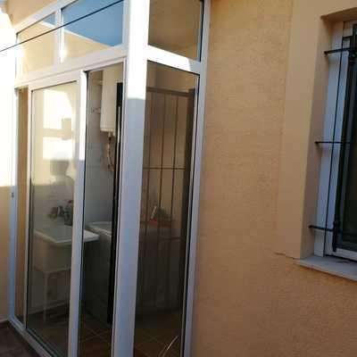 Serramiento de patio con corredera de aluminio marco inferior reducido