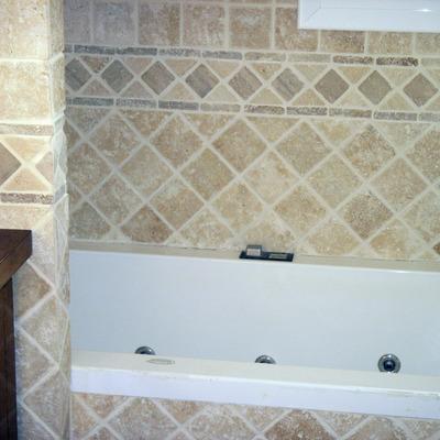 Alicatado de baño y colocación de bañera