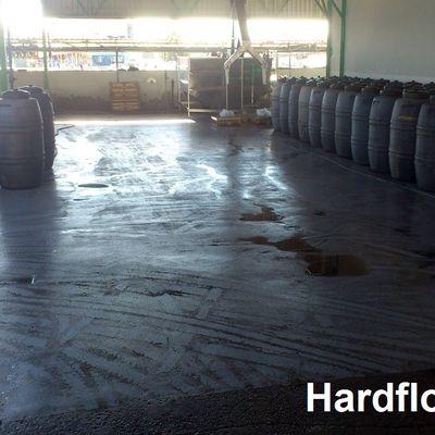 almazara aceitunas zona lavado bombonas con pavimento epoxi