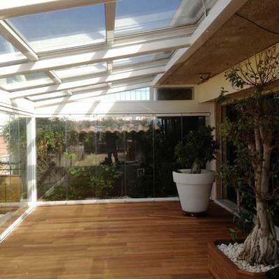 Techado terraza y cortina de cristal