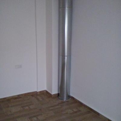 calefaccion en habitacion con parquet