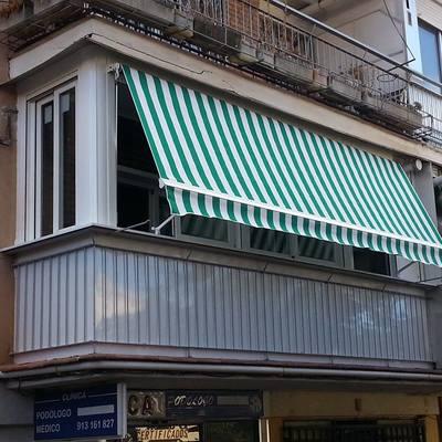 Cerramiento de terraza y toldo