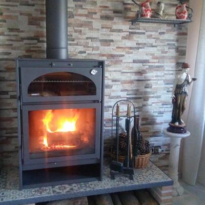 Estufa de leña con horno Carbel H-7 de Chimeneas Molina