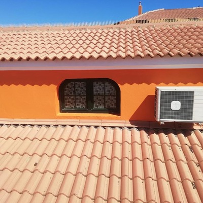 Pintura exterior de vivienda dúplex adosado