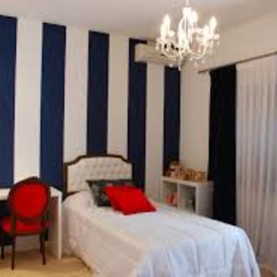 Dormitorio estilo moderno.
