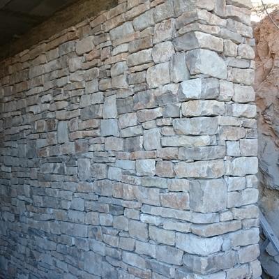Col.locació de pedra amb sec.