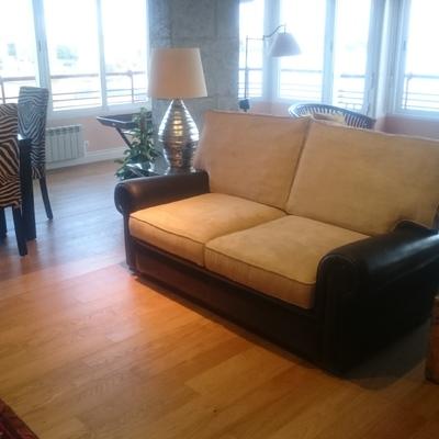 Sofa en piel y tegido sntimanchas