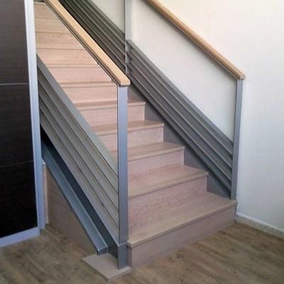 Escalera de Hierro revestida en parquet