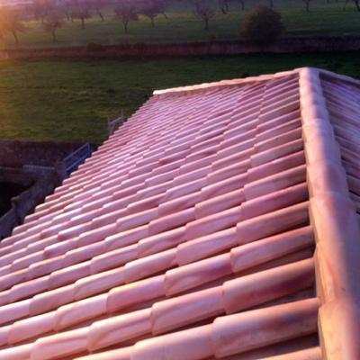 Formación de cubierta en porche existente.
