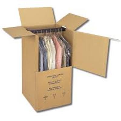 Guardado de trajes.  Camisas  en cajas percheros.