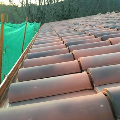Tejado ventilado, acabado en teja cerámica envejecida.