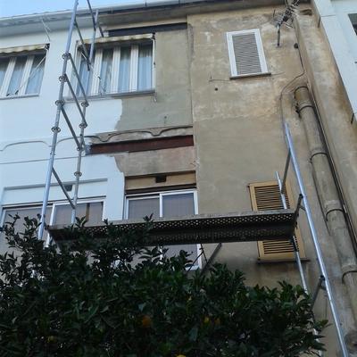 Saneado y pintura de fachada