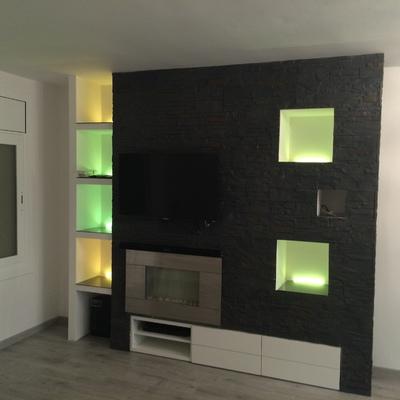 Mueble comedor de pladur forrado con piedra natural y luces LED