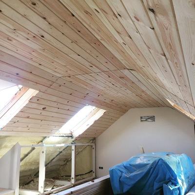 Aislamiento termico e instalación de lamas de madera.