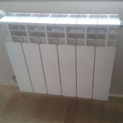Instalación de radiadores en vivienda