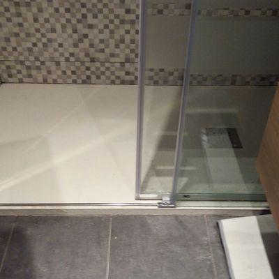 Plato de ducha con mosaico en el interior