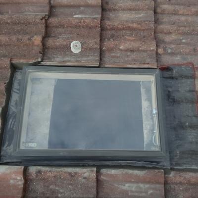 Colocacion de una lucera, para acceder al tejado.