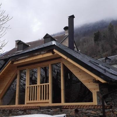 Balcón cristalera tejado